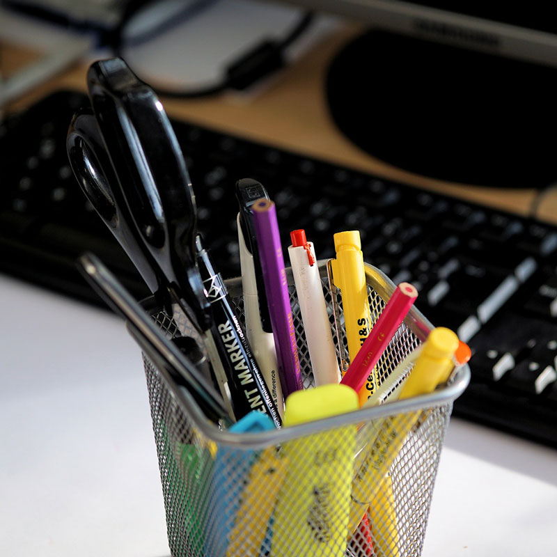 pot of pens and pencils on desk